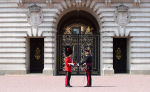 The Guard Commanders of the off going and on coming Queens Guard shake hands as part of the changeover tradition. Photo: Sgt Randall RLC