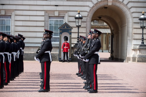 A Soldier from Number 7 Company Coldstream Guards awaits to be replaced by the Royal Logistic Corps Photo: Sgt Randall RLC