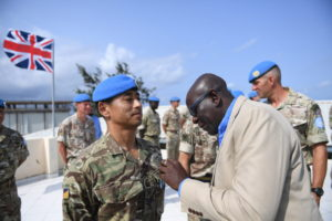 Sgt Gurung receives his UN Special Service Medal from Director Mission support UNSOS Mr Amadu Kamara