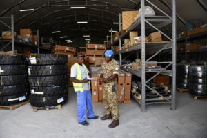 Cpl Ndongong receiving stock into the ES warehouse in Mogadishu