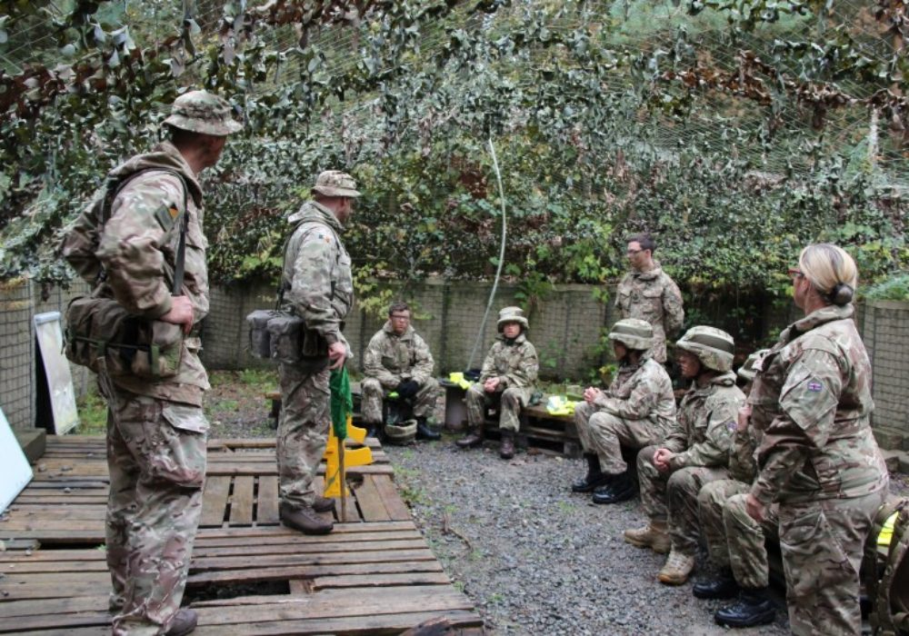 Cadets are briefed by DST staff on the close combat simulation