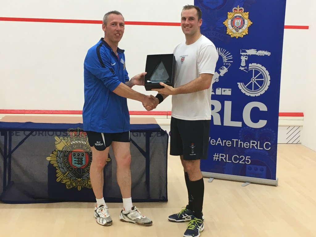 SSgt Dean Boys receiving the RLC Squash Open Champion trophy