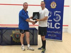 SSgt Dean Boys receiving the RLC Squash Open Champion trophy