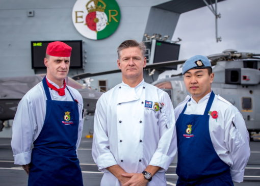 RLC chef LCpl Scott is working onboard HMS QUEEN ELIZABETH alongside Royal Naval chefs